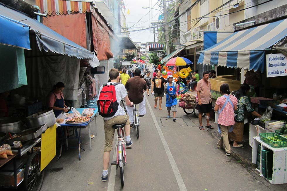 Cycling though small streets in Bangkok