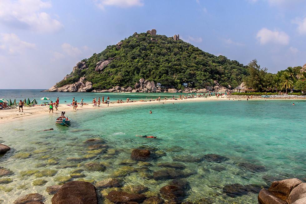 Small sandy beach full of tourists