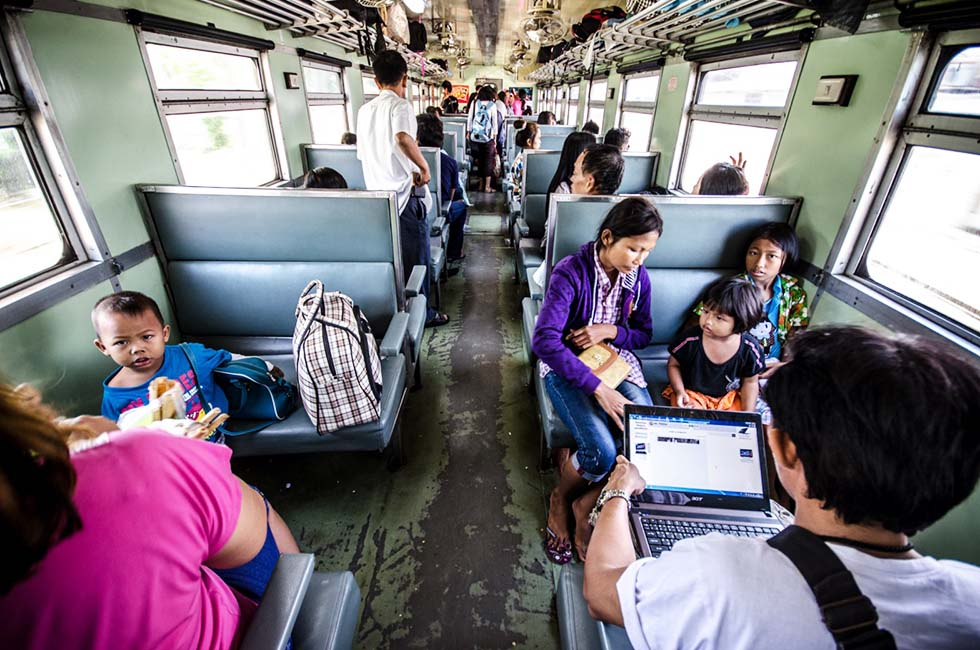 Riding a local train in Thailand