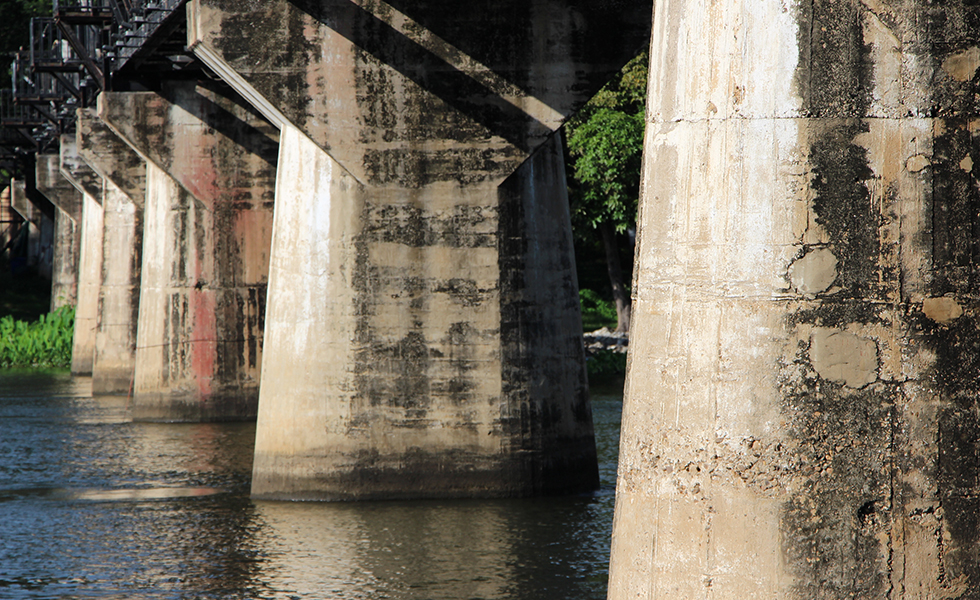 Aged pillars of The Bridge on the River Kwai in Kanchanaburi