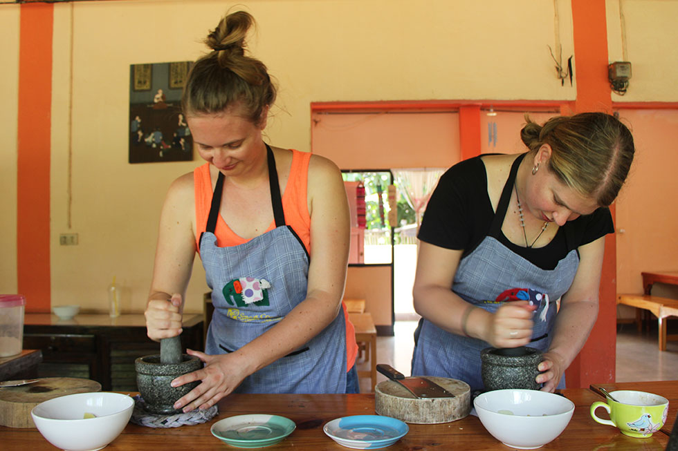 Me and my sister pounding away - Cooking class in Chiang Mai