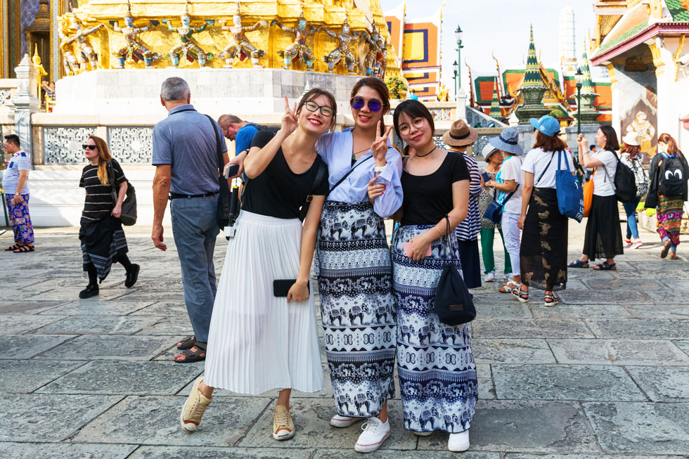 Cover your knees and shoulders in and around Thai temples