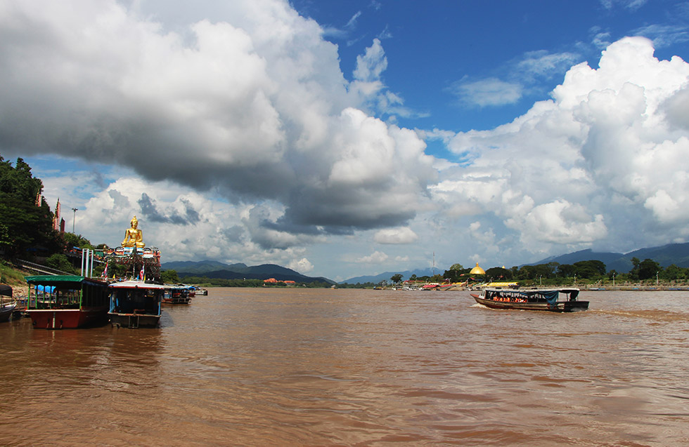 A cruise boat floating over the Mekong River