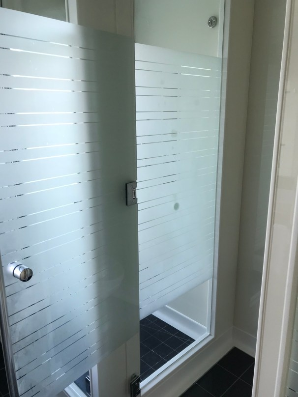Master bath glass doors to shower and toilet room