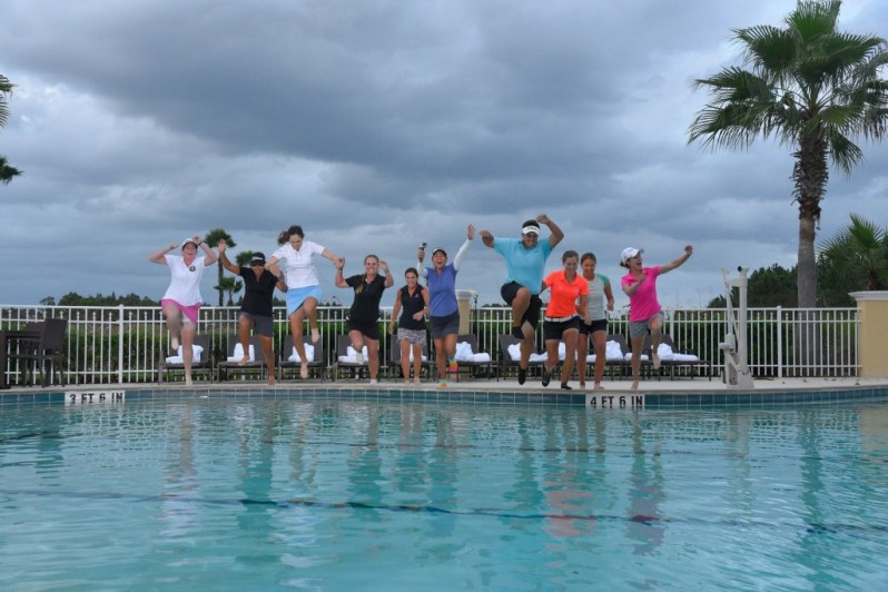 Image of qualifiers jumping into pool