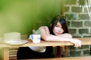 candid portrait with melancholic woman