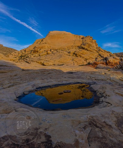 small pool reflecting Red Rock Nevada - gottatakemorepix