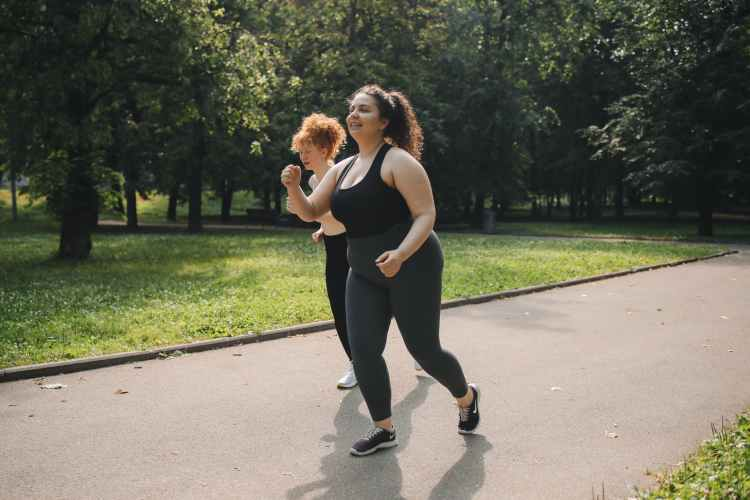 two women jogging together