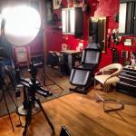 Setting up camera and lighting equipment in tattoo studio