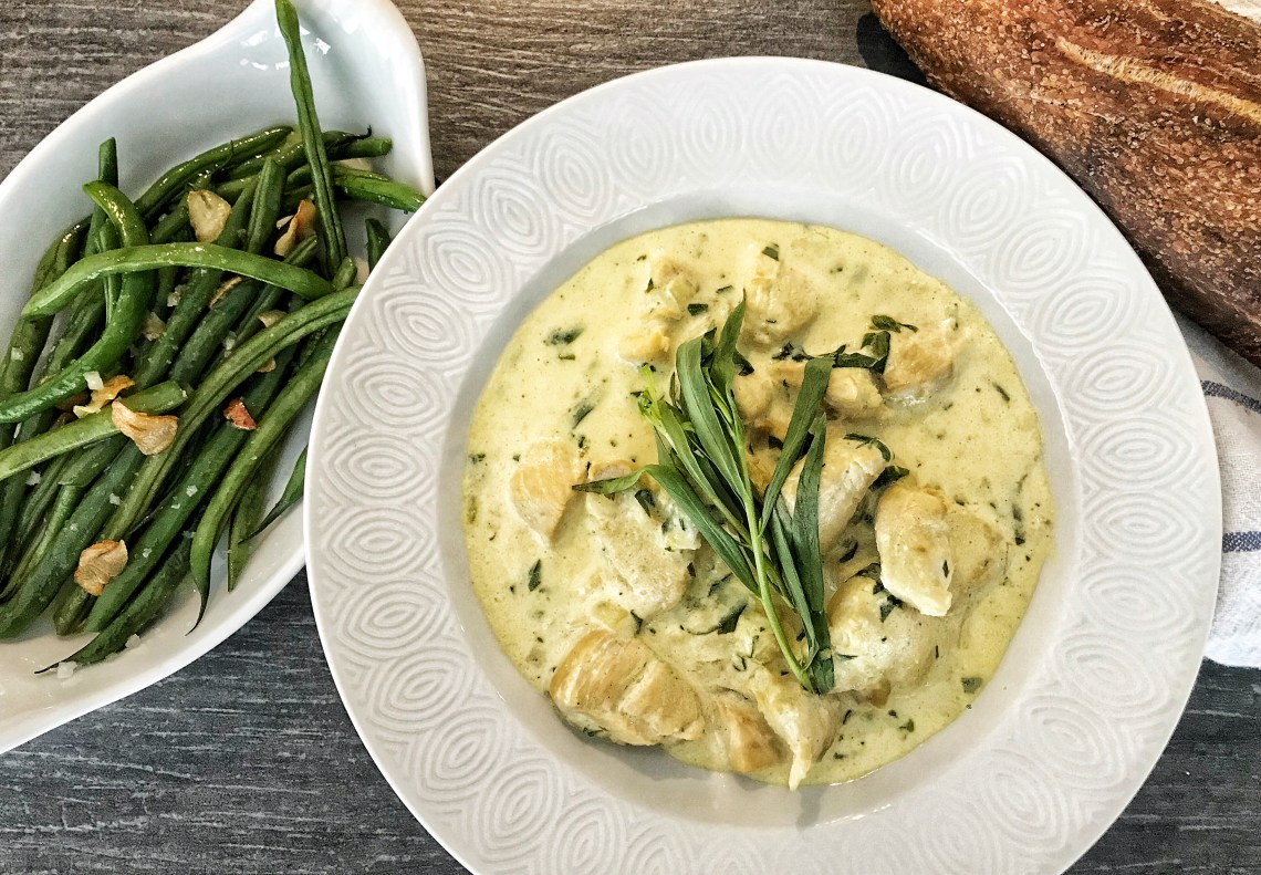 Creamy chicken tarragon with garlic French green beans and baguette