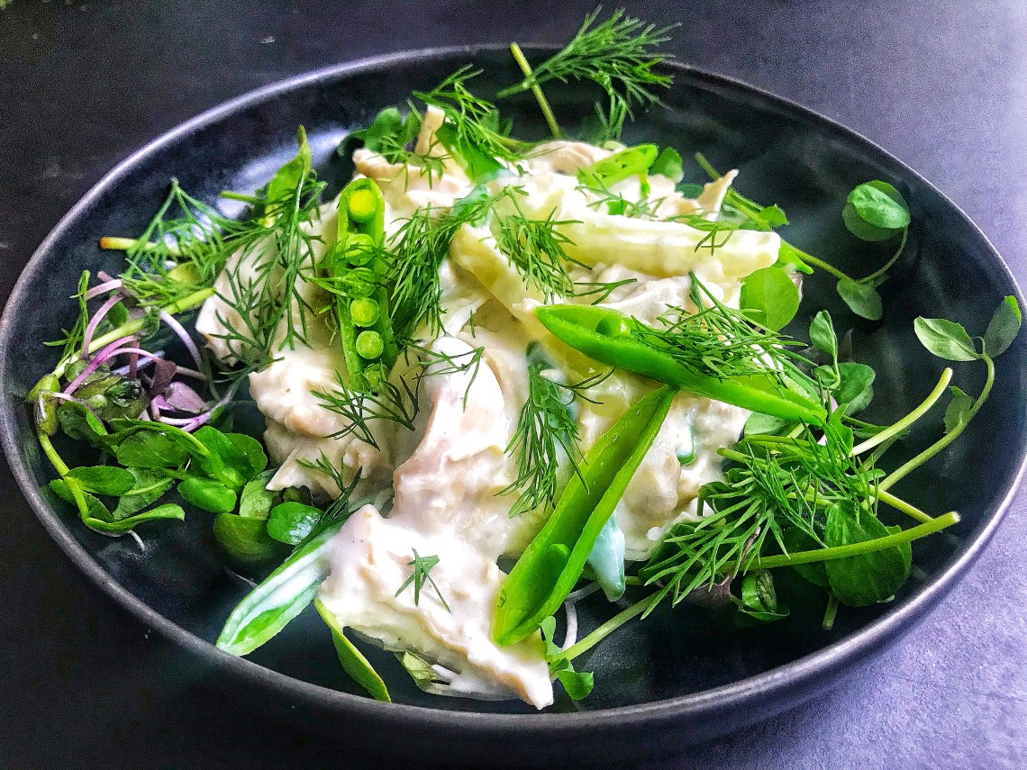 Chicken in creamy horseradish sauce with snap peas, fennel, pea shoots and dill