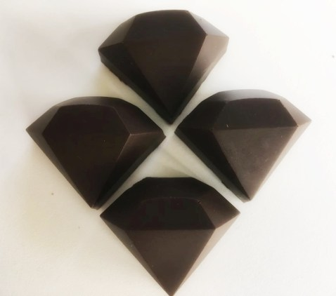 Homemade cognac ganache chocolate made in gem shaped chocolate molds.