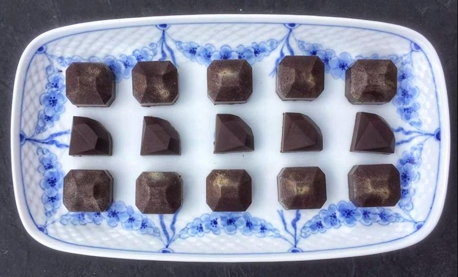 Cognac ganache chcolate gems served on a Royal Copenhagen platter