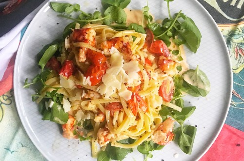 Lobster pasta with cognac cream sauce, cherry tomatoes and Parmesan on top