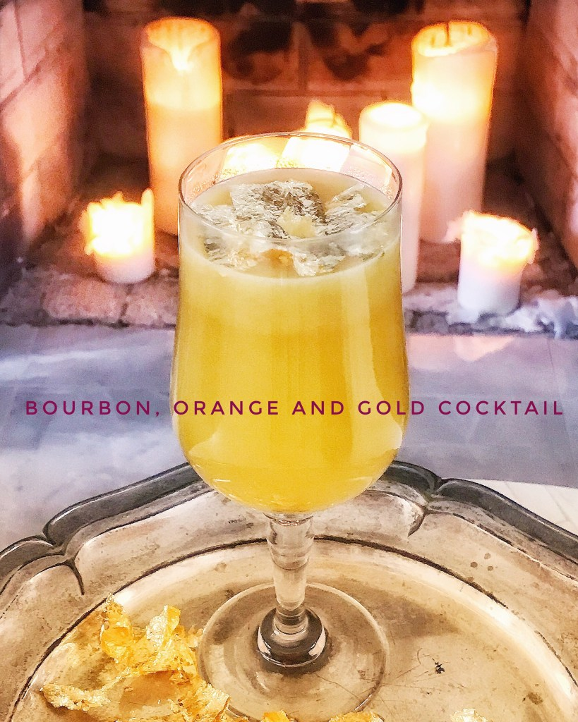 Bourbon and bubbles and other cocktails. Bourbon, orange juice and gold leaf cocktail