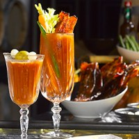 Get Boozy at Manhattan Bar's New Sunday Cocktail Brunch Launching Aug 10