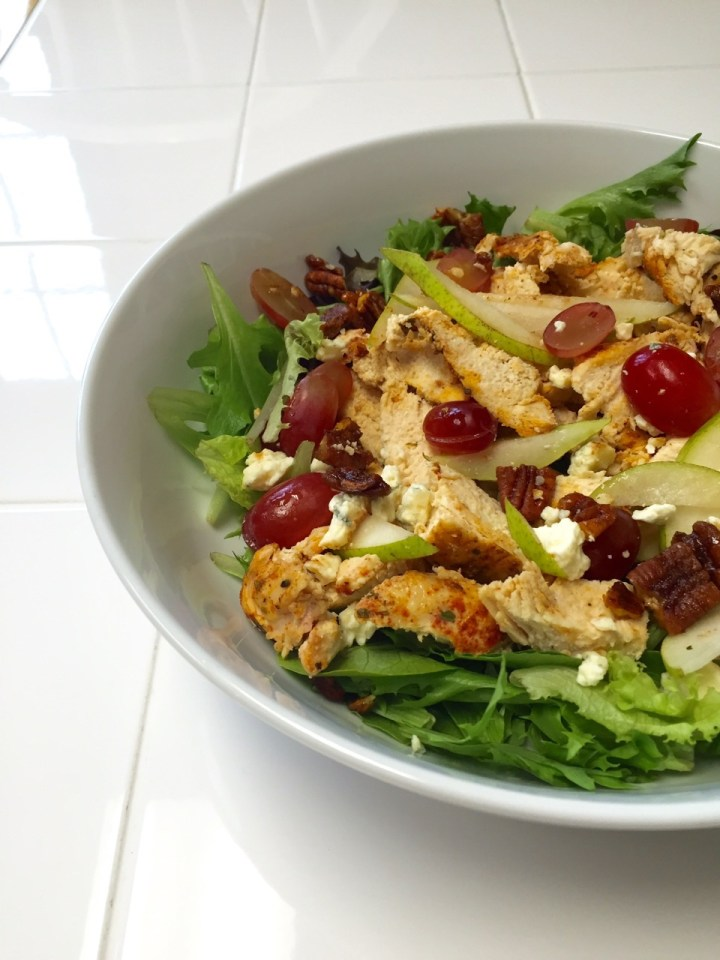 My latest favorite salad topped with chicken, halved grapes, sliced pear, gorgonzola cheese and a balsamic drizzle.