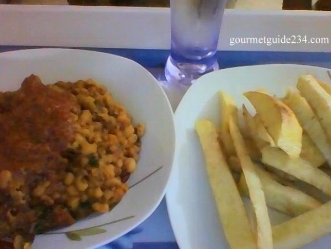 Beans porridge and fried yam with a pglass of water hmmmn! [proudly Nigerian]