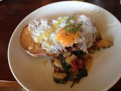 Corned beef hash, spinach, potato, fried egg ($18)