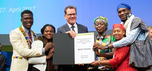 """Participants of the conference """"ONE World No Hunger"""" hand over the """"Berlin Charter"""" to Minister Muller."""