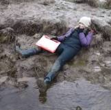corrinne laying in mud