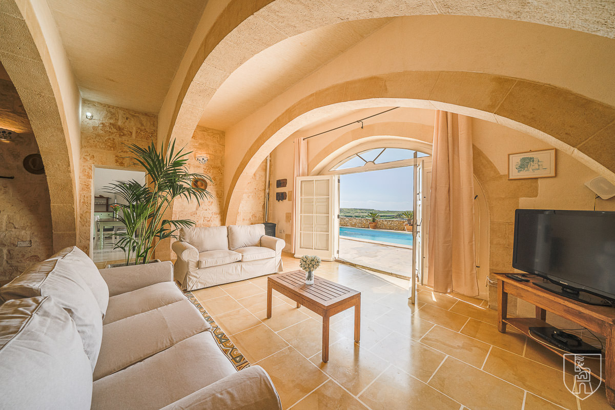 light-filled Living room of Ta Lonza Farmhouse with traditional Gozitan arches