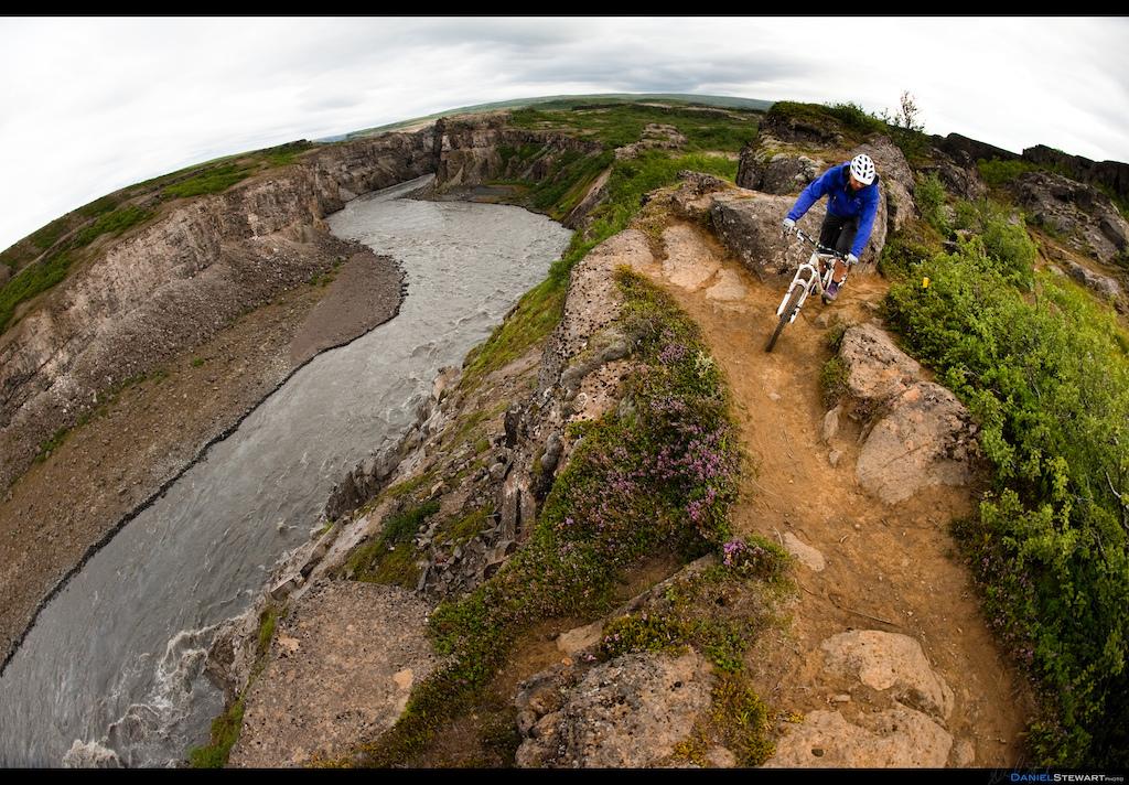 Bryce Borlick riding along the canyon rim of the J kuls Fj llum River