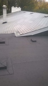Flat Roof Winnipeg below asphalt shingles
