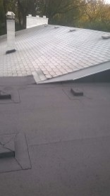 Flat Roof Winnipeg below asphalt shingles