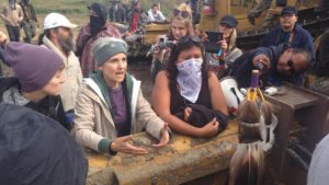 Green Party presidential candidate Jill Stein, center, meets with Dakota Access Pipeline protester