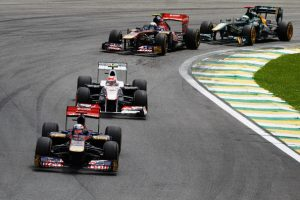 Buemi leads a number of cars in the Brazilian Grand Prix, his final race. (LAT)