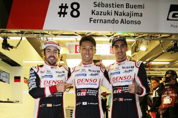 Buemi, Nakajima, and some Spanish bloke they met in the paddock.
