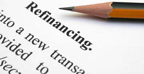 pencil on paper with the word refinancing at the top