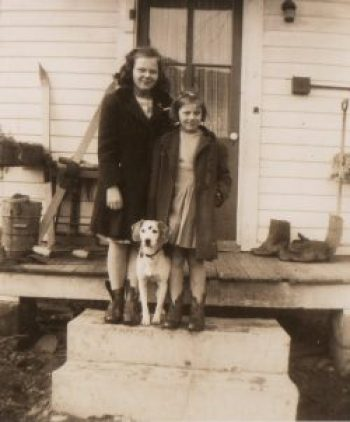 My sister Carmilla, our dog Skippy and me on the porch
