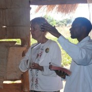 "Elly and interpreter teaching ""Wheel and Line"" message in Malawi"