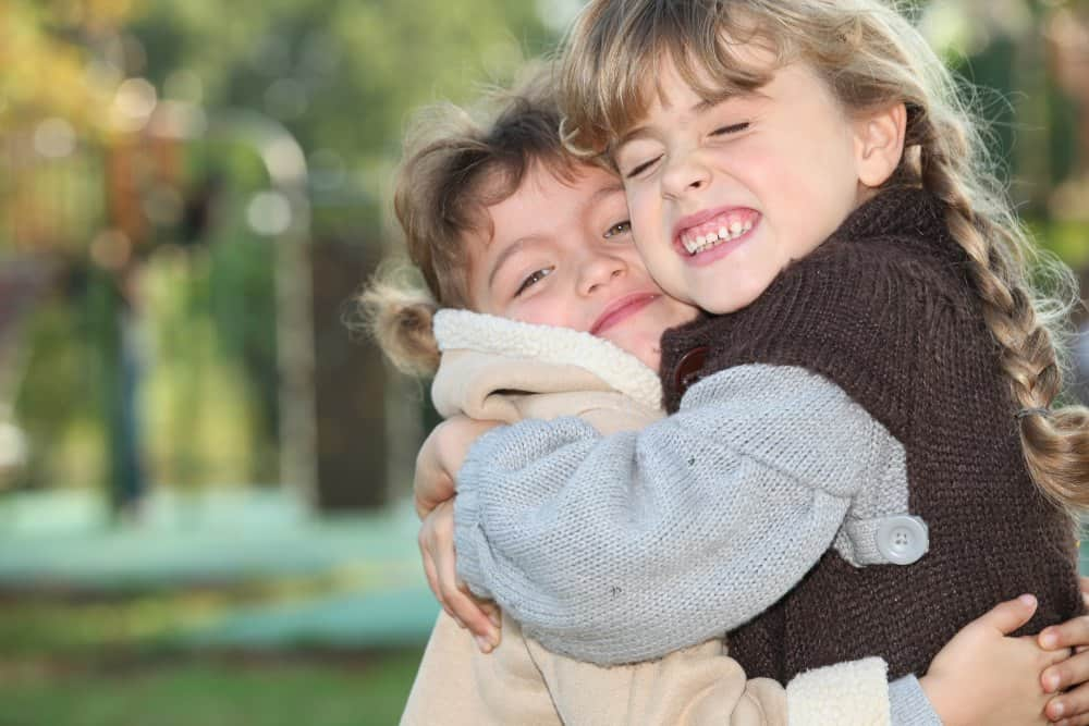 girls hugging for random acts of kindness at school