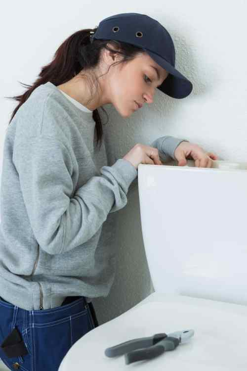 single mom fixing a toilet