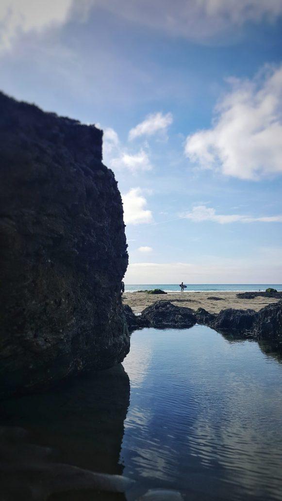 Porthtowan sufer on the beach