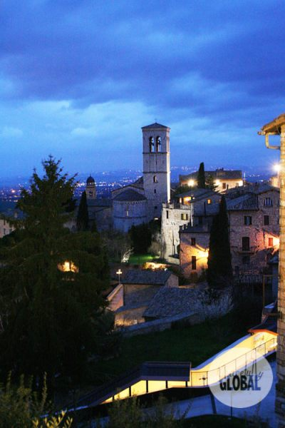 The twinkling lights of Assisi bring it to life at dusk.