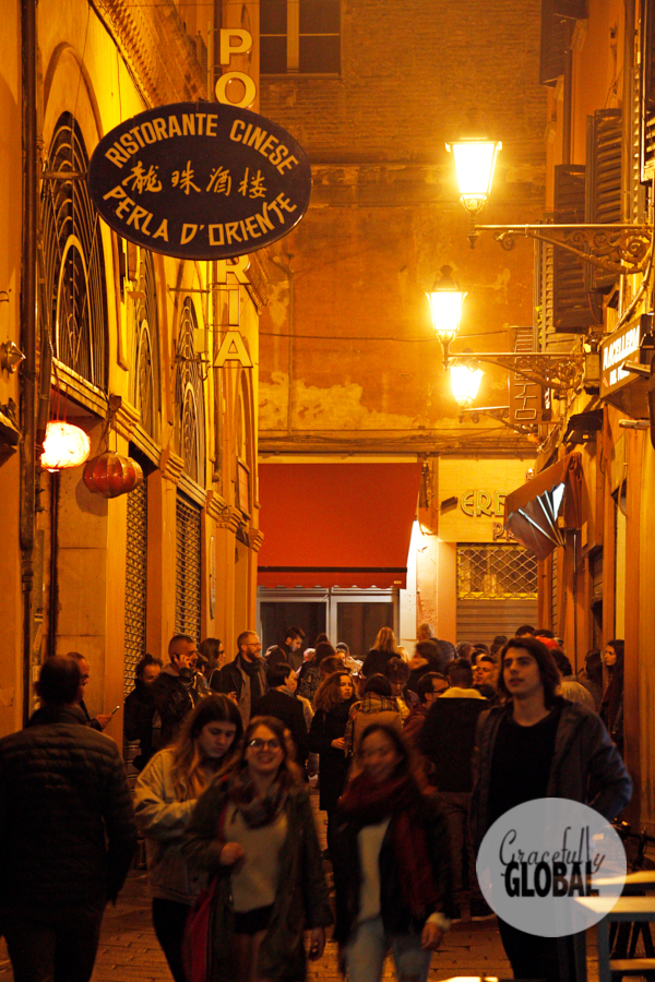 Crowds fill up Bologna's historic center going to local restaurants and bars.