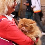 A woman carries her cat through Rome, Italy