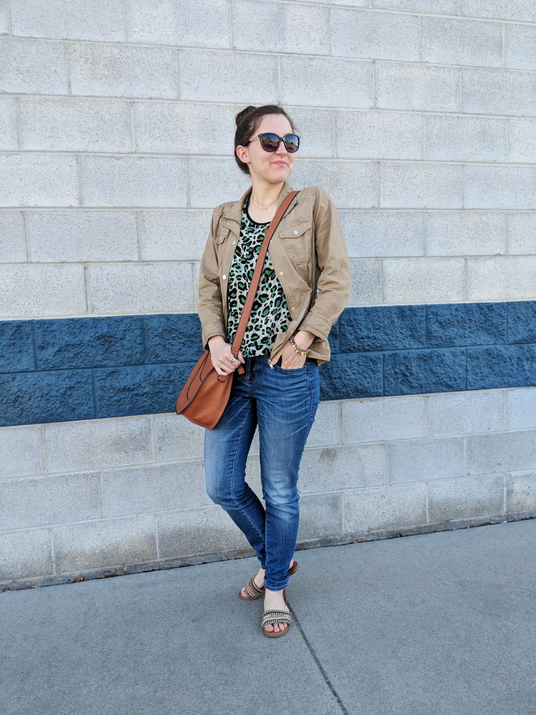 green leopard blouse, khaki anorak, blue jeans