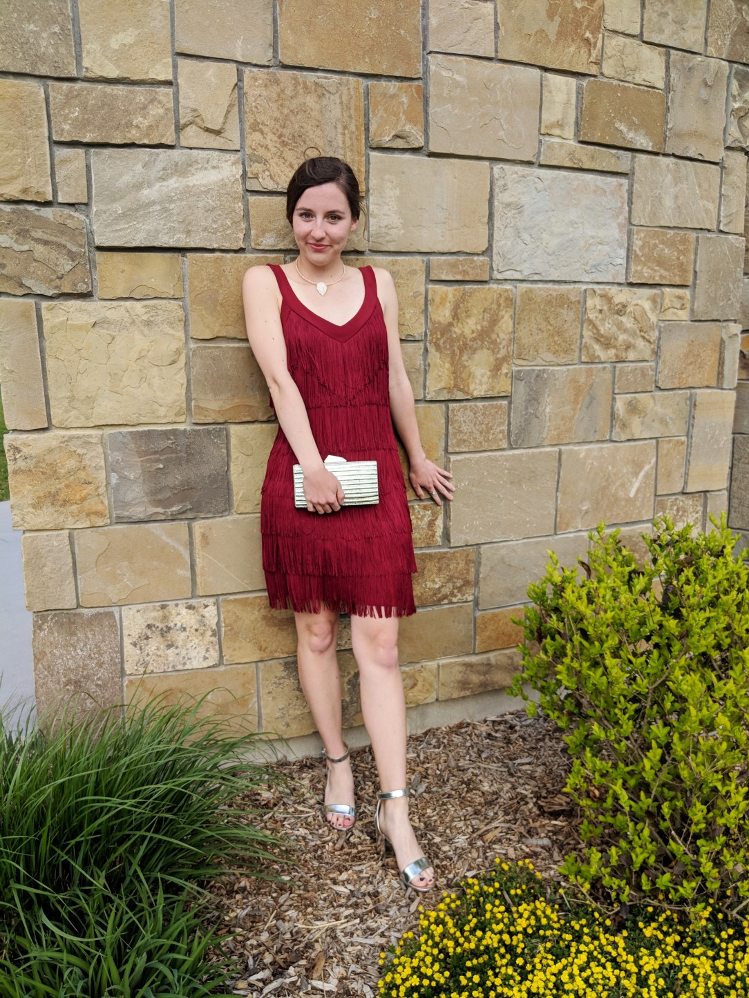 red fringe dress, silver purse, silver heels