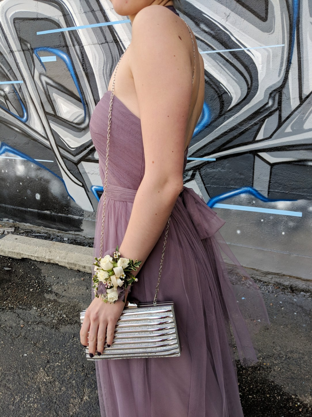 mauve prom dress, corsage, silver clutch