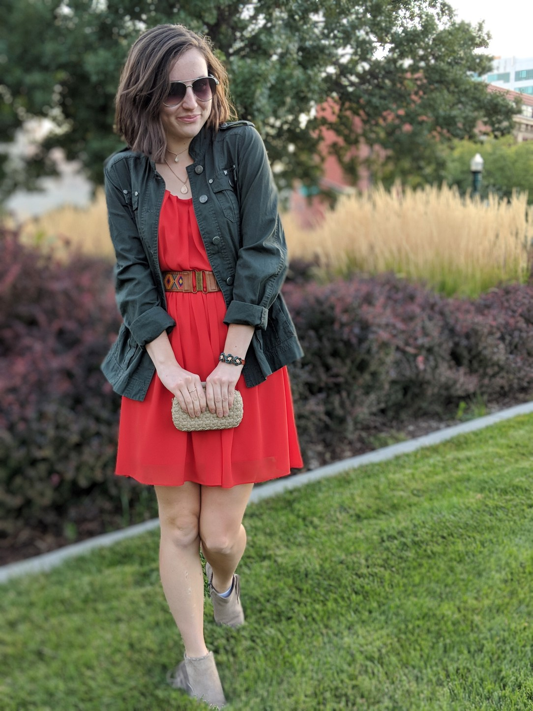 orange dress, army green military jacket, beige booties