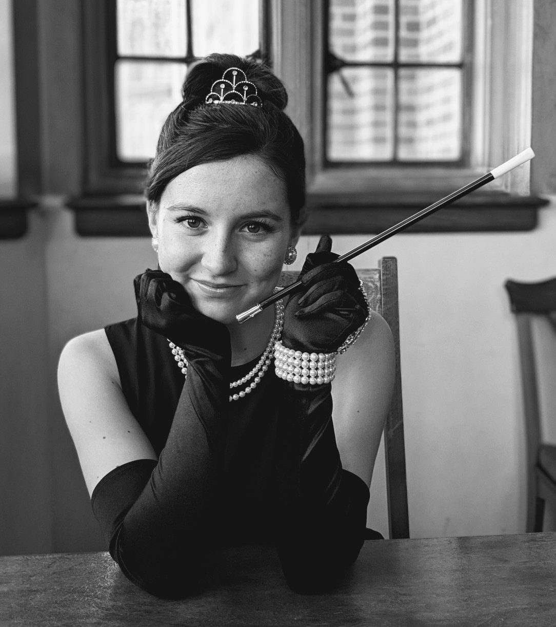 Wearing an Audrey Hepburn costume to recreate an iconic photo