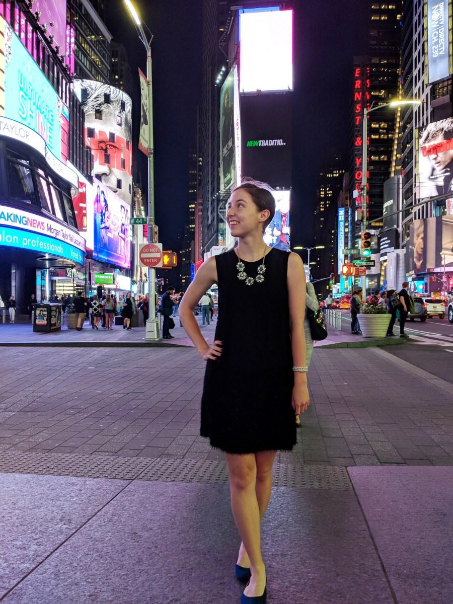 black dress blue flats Times Square