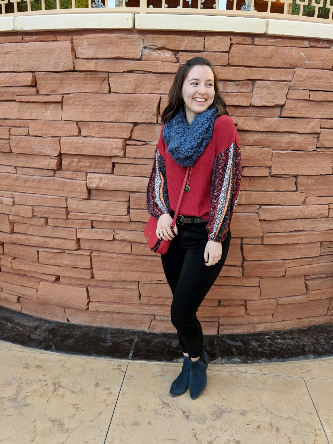 red patterned shirt with blue infinity scarf