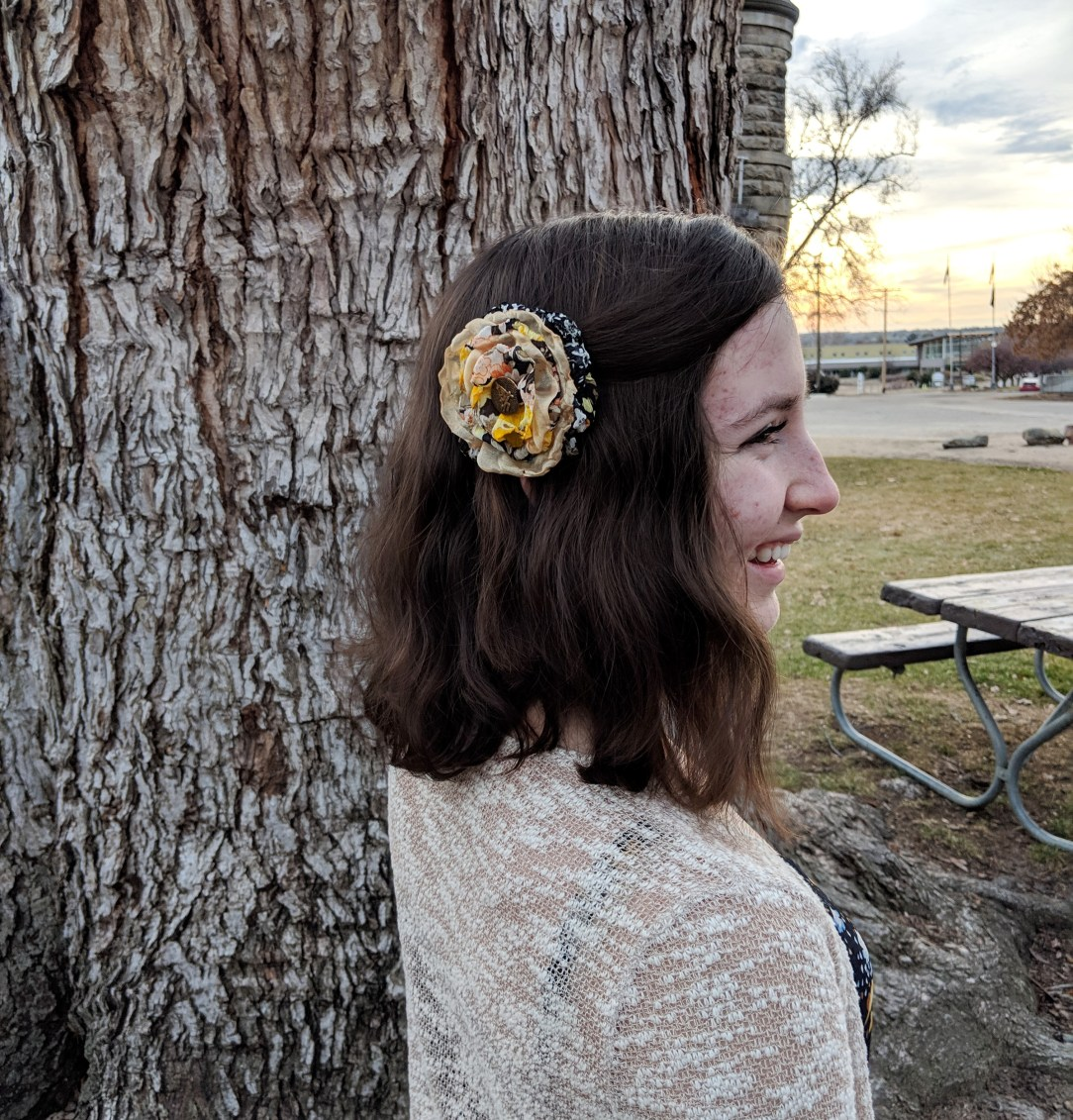 yellow flower in hair