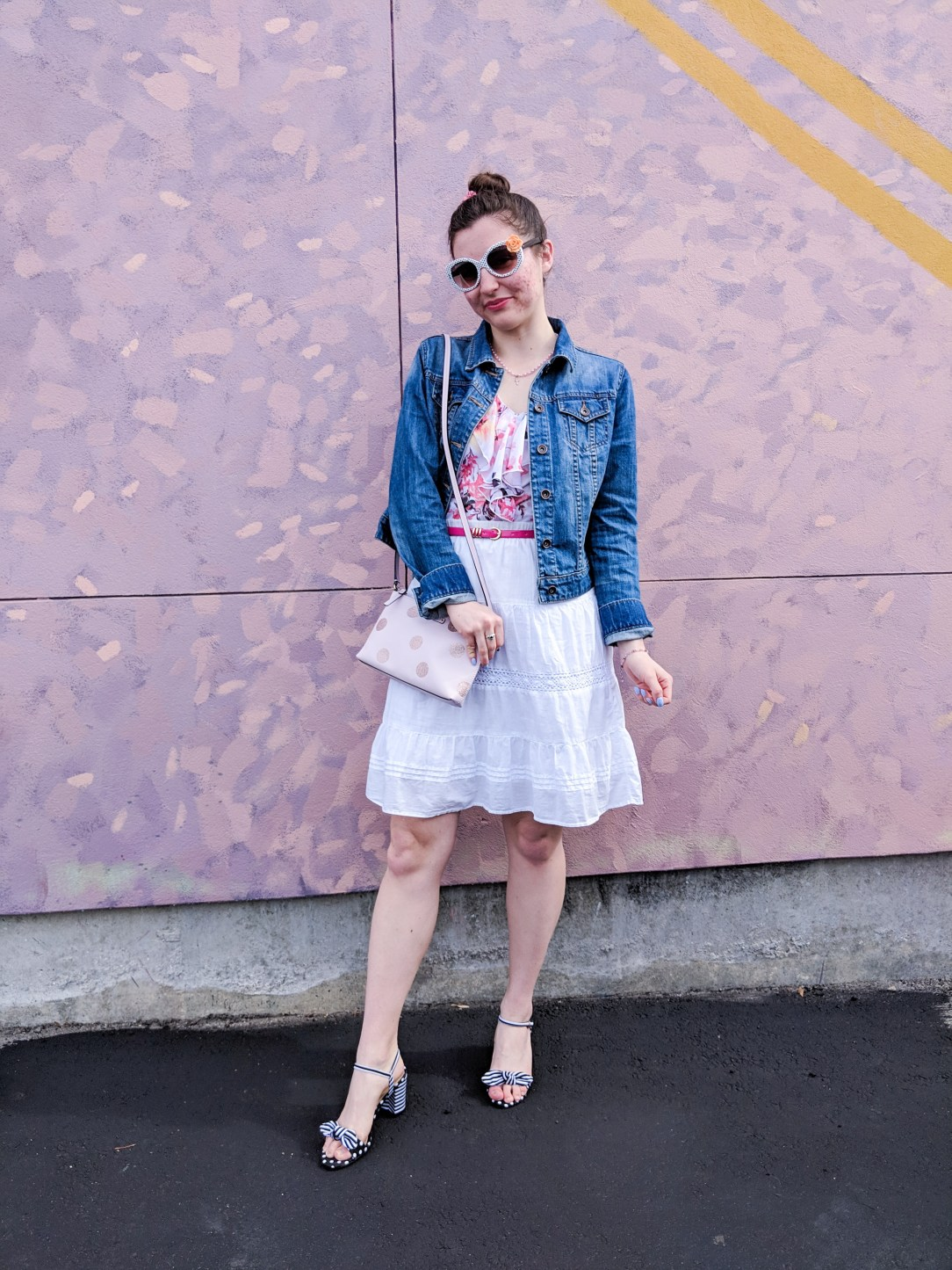 spring outfit with white skirt, floral blouse, jean jacket